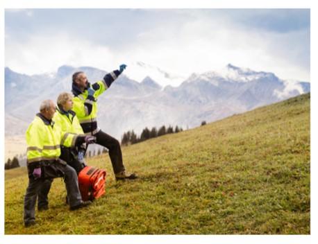 3 emergency service staff on a hillside